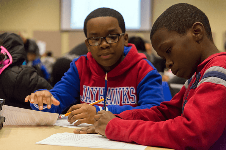 two students learn financial literacy skills