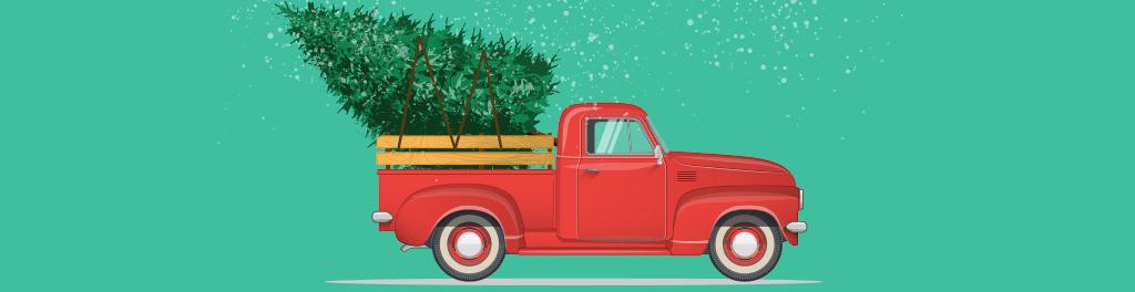 A red pickup truck hauling a Christmas tree in the back